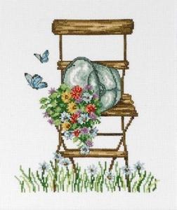 Bloemenemmer op tuinstoel